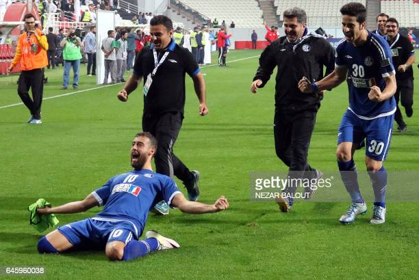 Iran's Esteghlal Khuzestan players and staff celebrate after they won an Asian Champions League Group B football match against UAE's alJazira at...