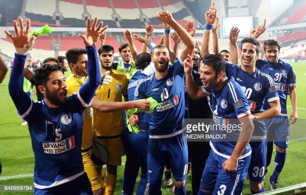 Iran's Esteghlal Khuzestan players celebrate after they won an Asian Champions League Group B football match against UAE's alJazira at Mohammed Bin...