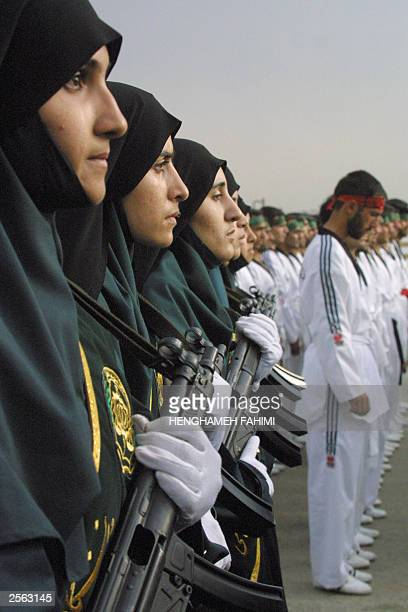 Iran's first group of female police officers since the 1979 Islamic revolution stand in line along with male comrades during a gradation ceremony at...