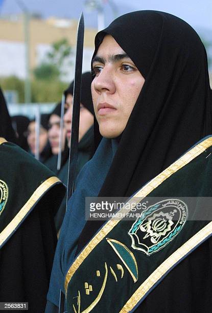 Iran's first group of female police officers since the 1979 Islamic revolution stand in line during a gradation ceremony at Tehran's police academy...