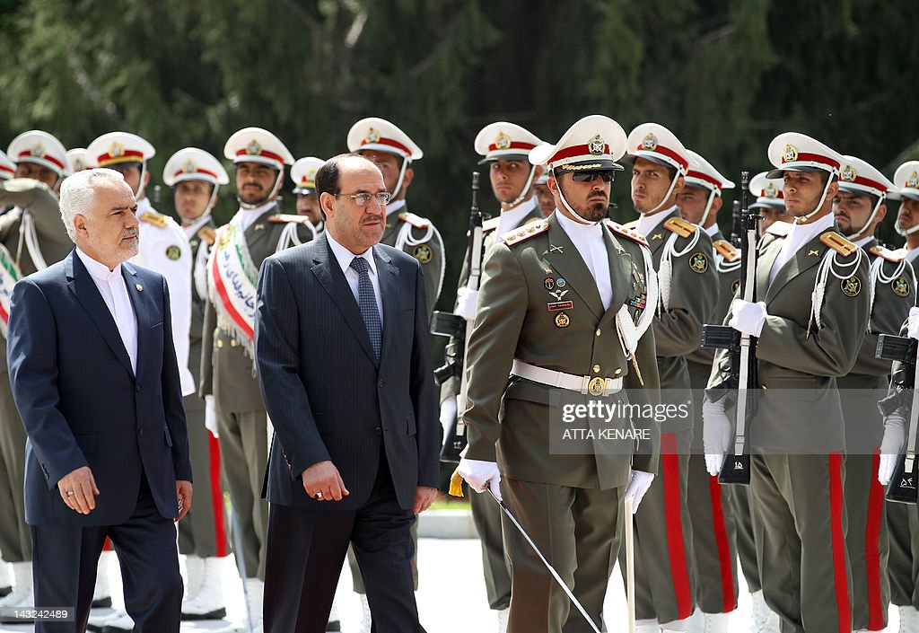 Iran's First Vice President Mohammad Reza Rahimi (L) and Iraqi Prime Minister Nouri al-Maliki (2nd L) review the honour guard in Tehran on April 22, 2012 upon the latter's arrival for two days of meetings with Iranian leaders and senior officials on various bilateral issues. The visit notably comes ahead of an important May 23 meeting to be hosted in Baghdad between Iran and the P5+1 group of world powers on Tehran's disputed nuclear programme.
