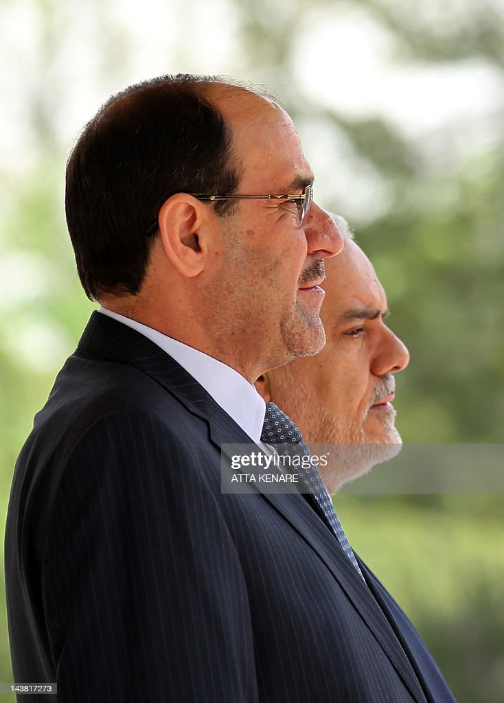 Iran's First Vice President Mohammad Reza Rahimi (R) and Iraqi Prime Minister Nouri al-Maliki (L) listen to their national anthems during a welcoming ceremony in Tehran on April 22, 2012 upon the latter's arrival for two days of meetings with Iranian leaders and senior officials on various bilateral issues. The visit notably comes ahead of an important May 23 meeting to be hosted in Baghdad between Iran and the P5+1 group of world powers on Tehran's disputed nuclear programme.