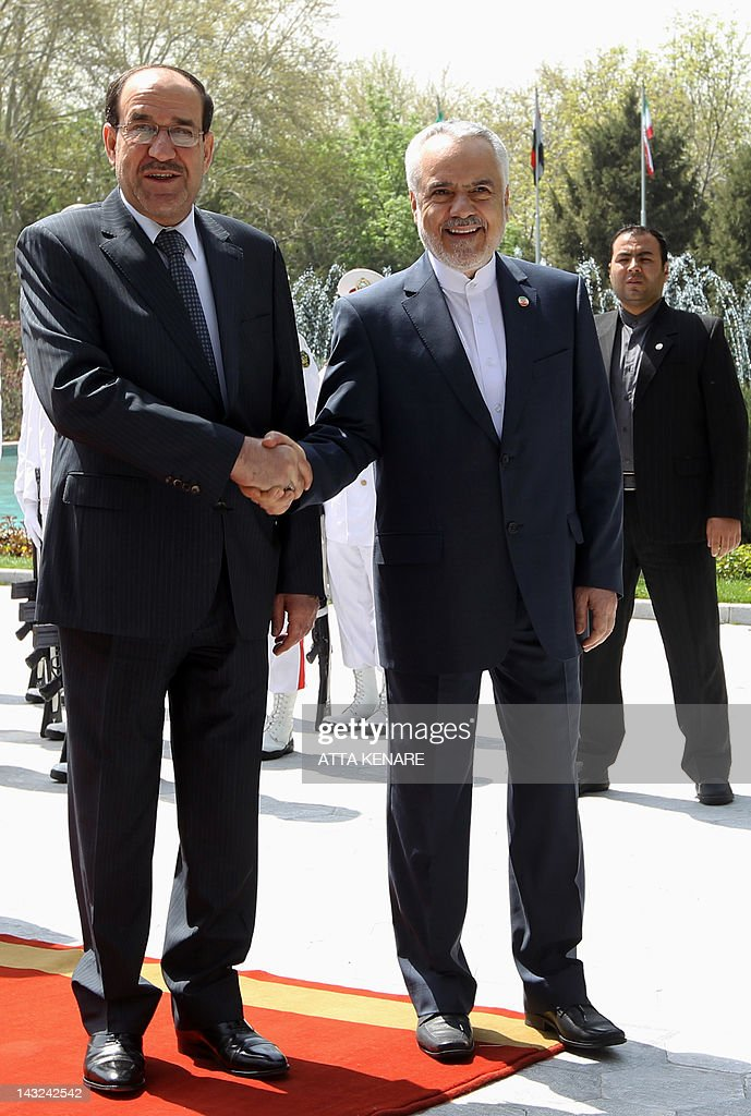 Iran's First Vice President Mohammad Reza Rahimi (R) shakes hands with Iraqi Prime Minister Nouri al-Maliki (L) during a welcoming ceremony in Tehran on April 22, 2012 upon the latter's arrival for two days of meetings with Iranian leaders and senior officials on various bilateral issues. The visit notably comes ahead of an important May 23 meeting to be hosted in Baghdad between Iran and the P5+1 group of world powers on Tehran's disputed nuclear programme.