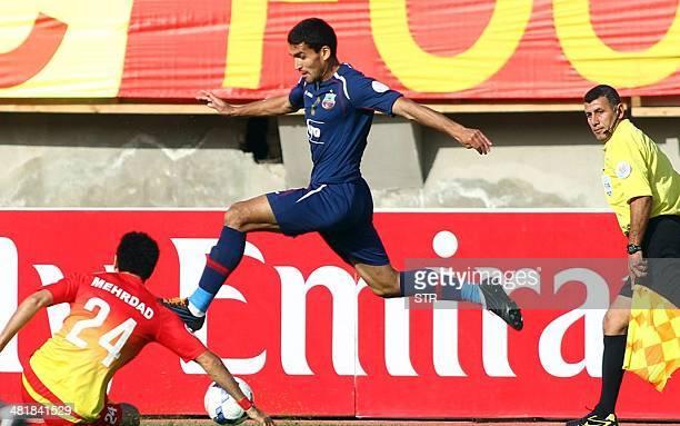Iran's Foolad Mehrdad Jamati challenges Akmal Shorakhmedov of Uzbekistan's Bunyodkor club during their AFC Asian Champions League Group B football...