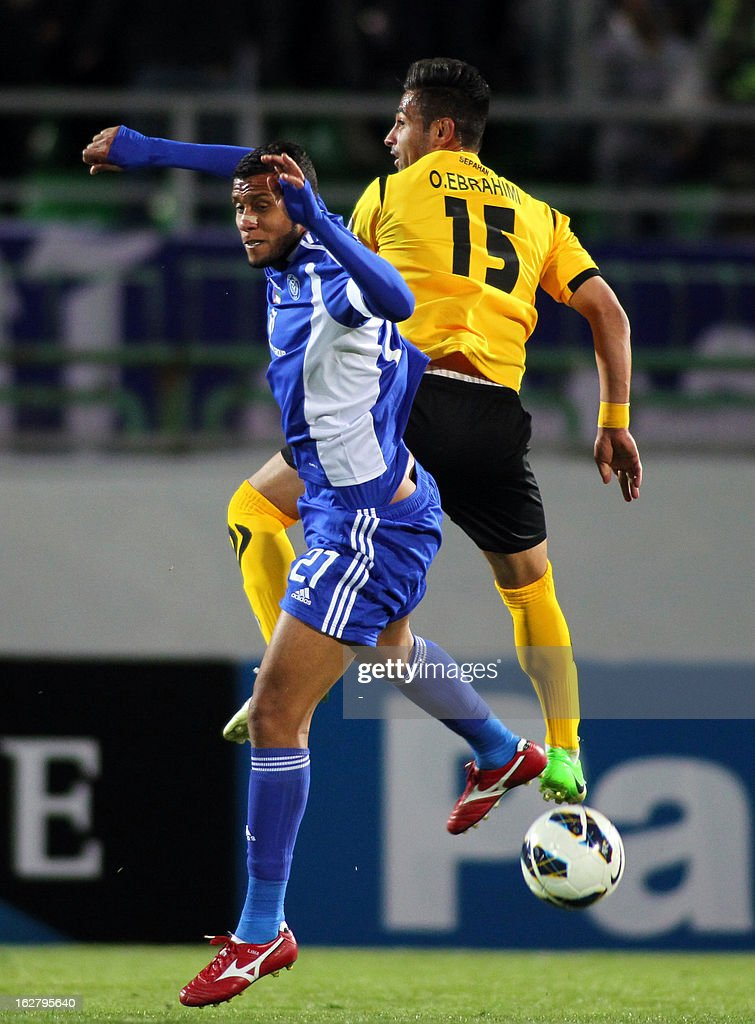 Iran's Foolad Sepahan player, Omid Ebrahimi (R) vies for the ball with UAE's Al-Nasr player, Younus Ahmed Abdullah (L) during their AFC Champions League group C football match at Foolad Shahr Stadium in Isfahan on February 27, 2013.