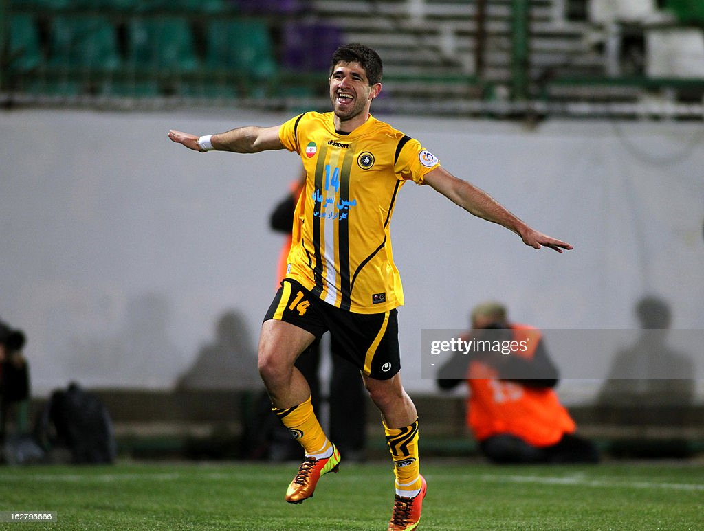 Iran's Foolad Sepahan player, Xhevahir Sukaj celebrates after scoring a goal against UAE's Al-Nasr during their AFC Champions League group C football match at Foolad Shahr Stadium in Isfahan on February 27, 2013.