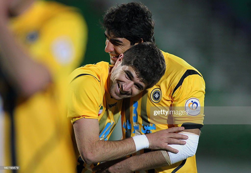 Iran's Foolad Sepahan players, Xhevahir Sukaj (L) and Farshid Talebi celebrate after scoring a goal against UAE's Al-Nasr during their AFC Champions League group C football match at Foolad Shahr Stadium in Isfahan on February 27, 2013. AFP PHOTO/STR