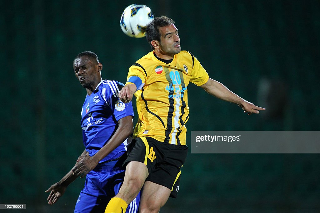 Iran's Foolad Sepahan's Ahmad Jamshidian (R) vies with UAE's Al-Nasr's Hilal Saeed (L) during their AFC Champions League group C football match at Foolad Shahr Stadium in the Iranian city of Isfahan on February 27, 2013. Sepahan defeated Al-Nasr 3-0. AFP PHOTO/STR