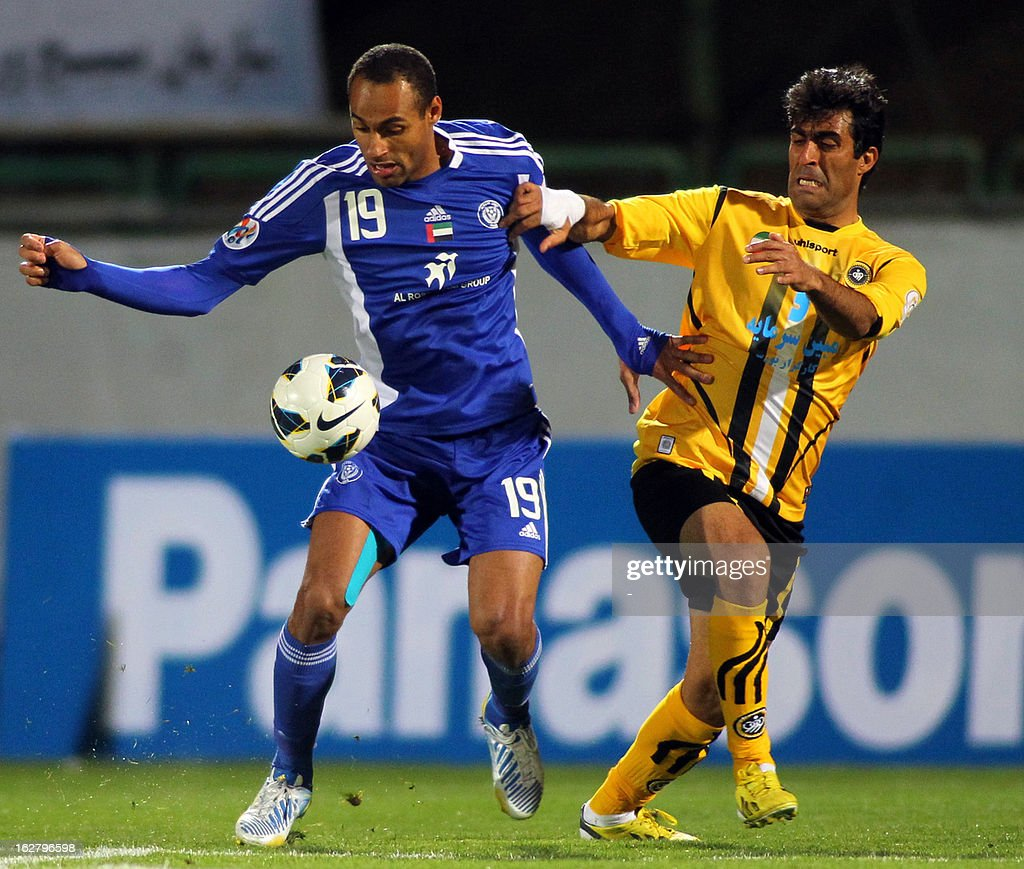 Iran's Foolad Sepahan's Mohammad Ali Ahmadi (R) vies with UAE's Al-Nasr's Bruno Cesar (L) during their AFC Champions League group C football match at Foolad Shahr Stadium in the Iranian city of Isfahan on February 27, 2013. Sepahan defeated Al-Nasr 3-0. AFP PHOTO/STR