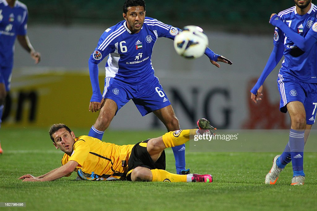 Iran's Foolad Sepahan's Mohammad Reza Khalatbari (bottom) vies with UAE's Al-Nasr's Ahmed Ali (up) during their AFC Champions League group C football match at Foolad Shahr Stadium in the Iranian city of Isfahan on February 27, 2013.