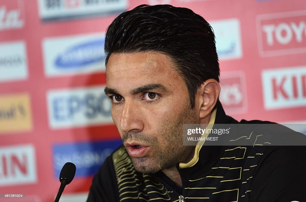 Iran's football captain <a gi-track='captionPersonalityLinkClicked' href=/galleries/search?phrase=Javad+Nekounam&family=editorial&specificpeople=555005 ng-click='$event.stopPropagation()'>Javad Nekounam</a> speaks to the media ahead of their upcoming match in the AFC Asian Cup in Melbourne on January 10, 2015. Iran will take on Bahrain in their first match to be played January 11. AFP PHOTO / William WEST --IMAGE