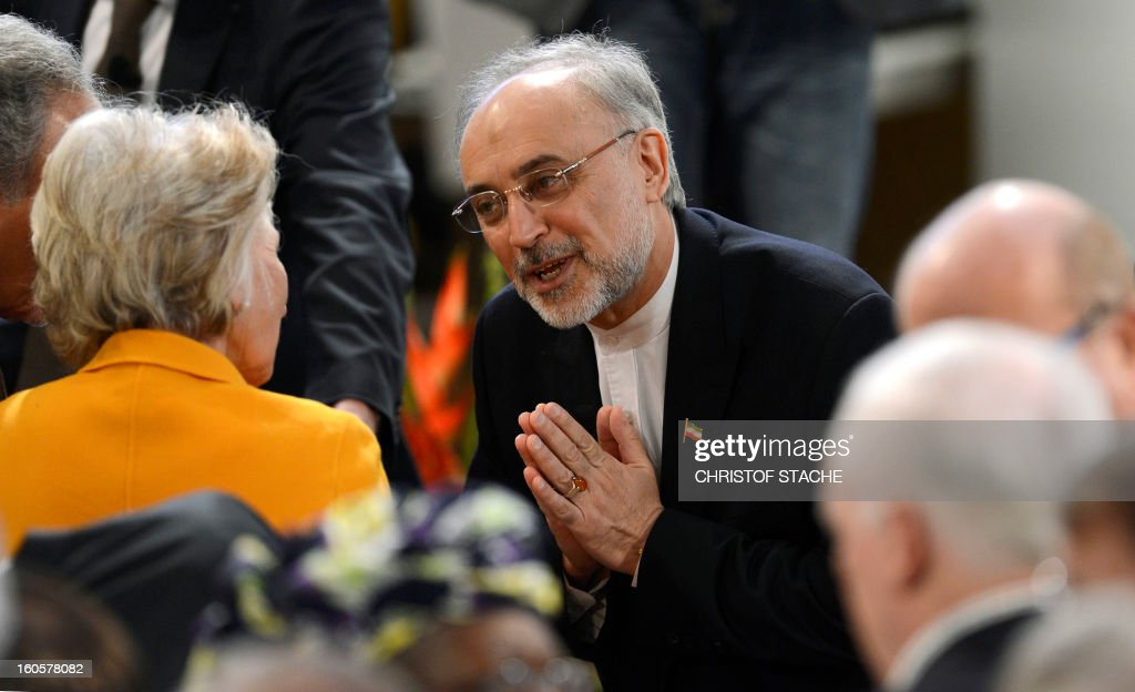 Iran's Foreign Minister Ali Akbar Salehi (C) greets US Director of the Woodrow Wilson Intenational Center for Scholars, Jane Margaret Harman on the third day of the 49th Munich Security Conference on February 3, 2013 in Munich, southern Germany as world leaders, ministers and top military gather for talks with the spotlight on Syria, Mali and Iran.