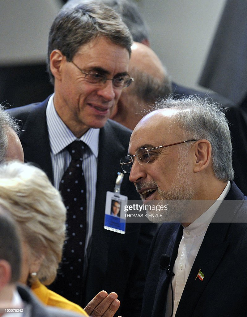 Iran's Foreign Minister Ali Akbar Salehi (R) talks to participants on the third day of the 49th Munich Security Conference on February 3, 2013 in Munich, southern Germany as world leaders, ministers and top military gather for talks with the spotlight on Syria, Mali and Iran.