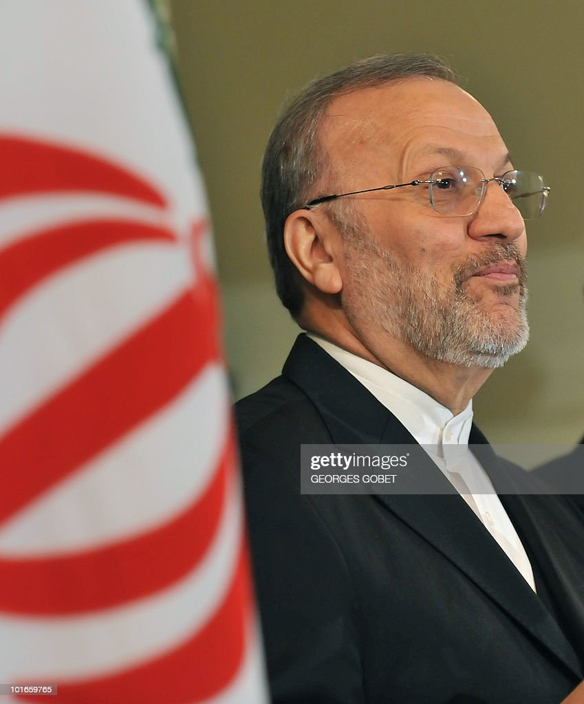 Iran's Foreign Minister Manouchehr Mottaki answers to journalists' questions on June 2, 2010 during a press conference at the Iranian embassy in Brussels. Mottaki warned that 'Fresh international sanctions against Iran over its nuclear programme could lead to confrontation' and denounced European 'intolerance' towards the Islamic veil, as France and Belgium move towards banning the burqa in public.