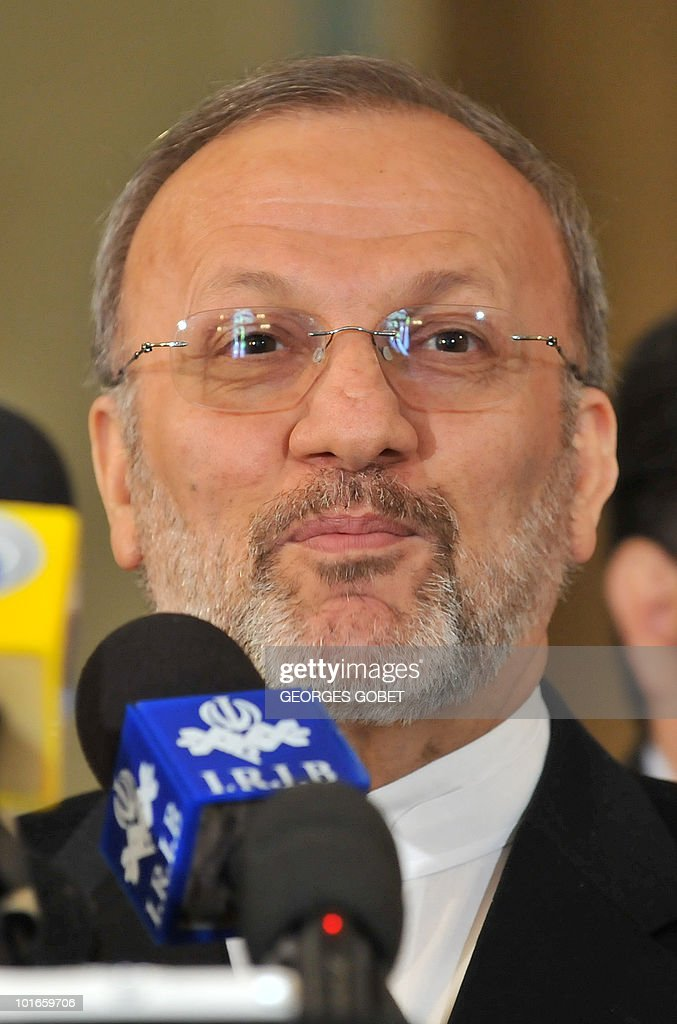 Iran's Foreign Minister Manouchehr Mottaki looks on as he answers to journalists' questions on June 2, 2010 during a press conference at the Iranian embassy in Brussels. Mottaki warned that 'Fresh international sanctions against Iran over its nuclear programme could lead to confrontation' and denounced European 'intolerance' towards the Islamic veil, as France and Belgium move towards banning the burqa in public.