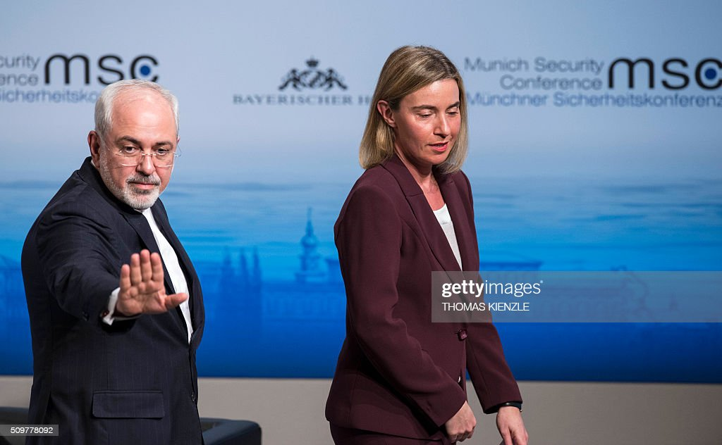 Iran's Foreign Minister Mohammad Javad Zarif (L) and EU foreign policy chief Federica Mogherini leave the room after speaking at the 52nd Munich Security Conference (MSC) in Munich, southern Germany, on February 12, 2016 KIENZLE