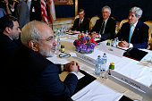 Iran's Foreign Minister Mohammad Javad Zarif meets with US Secretary of State John Kerry during talks between the foreign ministers of the six powers...