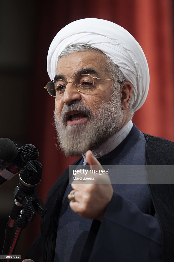 Iran's former nuclear negotiator and presidential candidate, <a gi-track='captionPersonalityLinkClicked' href=/galleries/search?phrase=Hassan+Rouhani+-+Politiker&family=editorial&specificpeople=641593 ng-click='$event.stopPropagation()'>Hassan Rouhani</a>, speaks to his supporters during a campaign rally on May 30, 2013 in Tehran, Iran. Rohani, 64, who is viewed by some as a moderate, and the other seven presidential candidates are due to come face-to-face in a televised debate tomorrow. The election is scheduled for June 14, 2013.