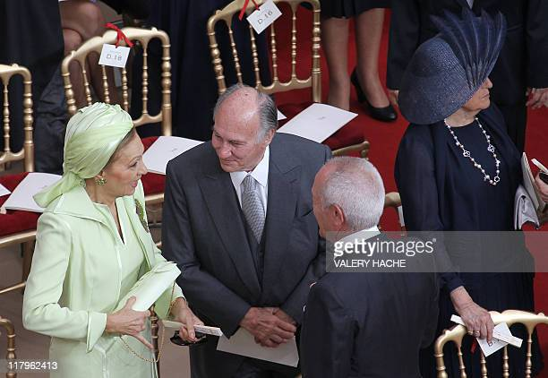 Iran's former Queen Farah Pahlavi flanked by Prince Karim Aga Khan arrives for the religious wedding of Prince Albert II of Monaco and Princess...