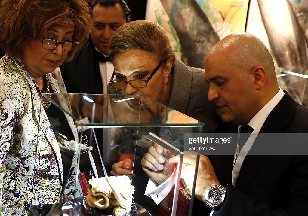 Iran's former Queen Farah Pahlavi (C) visits the 4th edition of the 'Art Monaco' contemporary art fair on April 25, 2013 in Monaco. The event takes place from April 25 to 28.