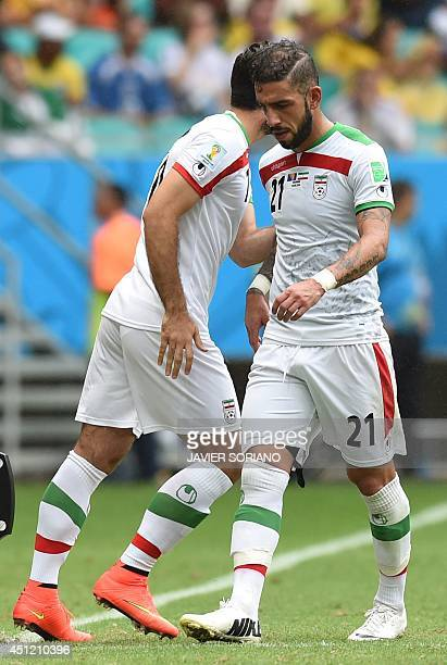 Iran's forward Ashkan Dejagah is substituted for Iran's forward Karim Ansari Fard during a Group F football match between BosniaHercegovina and Iran...