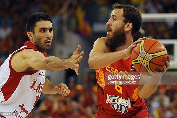 Iran's guard Hamed Afagh vies with Spain's guard Sergio Rodriguez during the 2014 FIBA World basketball championships group A match Iran vs Spain at...