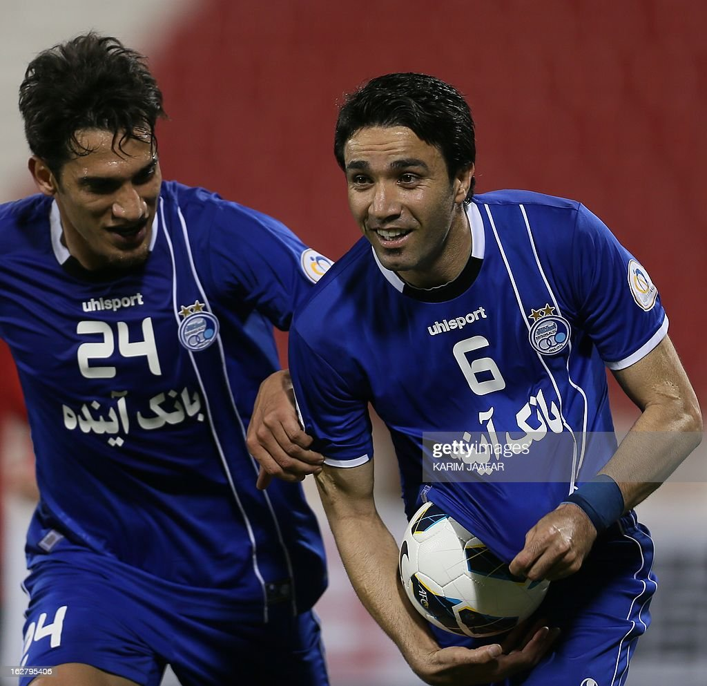 Iran's Javad Nekonam (R) celebrates after scoring a goal during the AFC Champions League football match Iran's Esteghlal versus Qatar's al-Rayyan clubs in the Qatari capital Doha on February 27, 2013.