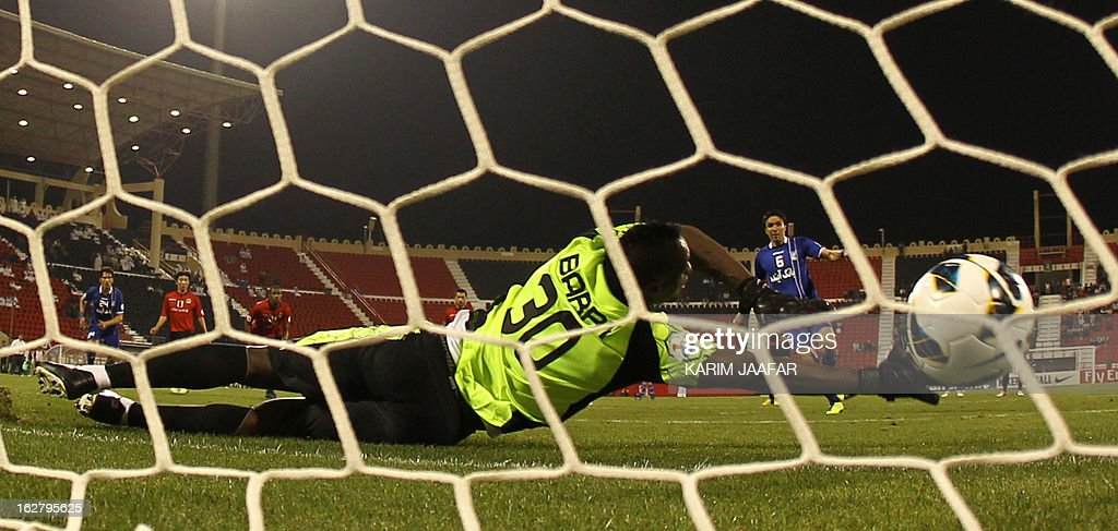 Iran's Javad Nekonam shoots and scores a goal in front of Qatar's goalkeeper during the AFC Champions League football match Iran's Esteghlal versus Qatar's al-Rayyan clubs in the Qatari capital Doha on February 27, 2013. AFP PHOTO / AL-WATAN DOHA / KARIM JAAFAR == QATAR OUT ==