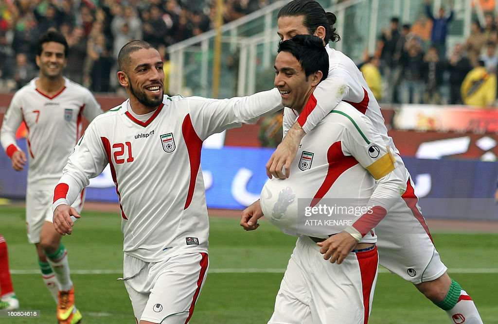 Iran's Javad Nekounam (R) celebrates after scoring a goal against Lebanon during their 2015 AFC Asian Cup group B qualifying football match at the Azadi Stadium in Tehran on February 6, 2013. Iran won the match 5-0.