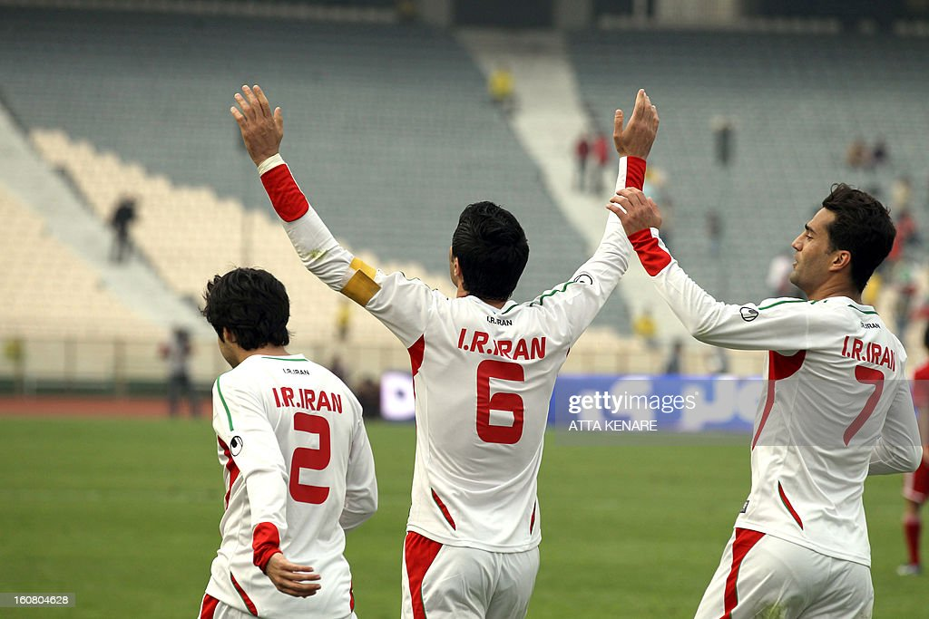 Iran's Javad Nekounam (C) celebrates after scoring a goal against Lebanon during their 2015 AFC Asian Cup group B qualifying football match at the Azadi Stadium in Tehran, on February 6, 2013. Iran won the match 5-0.