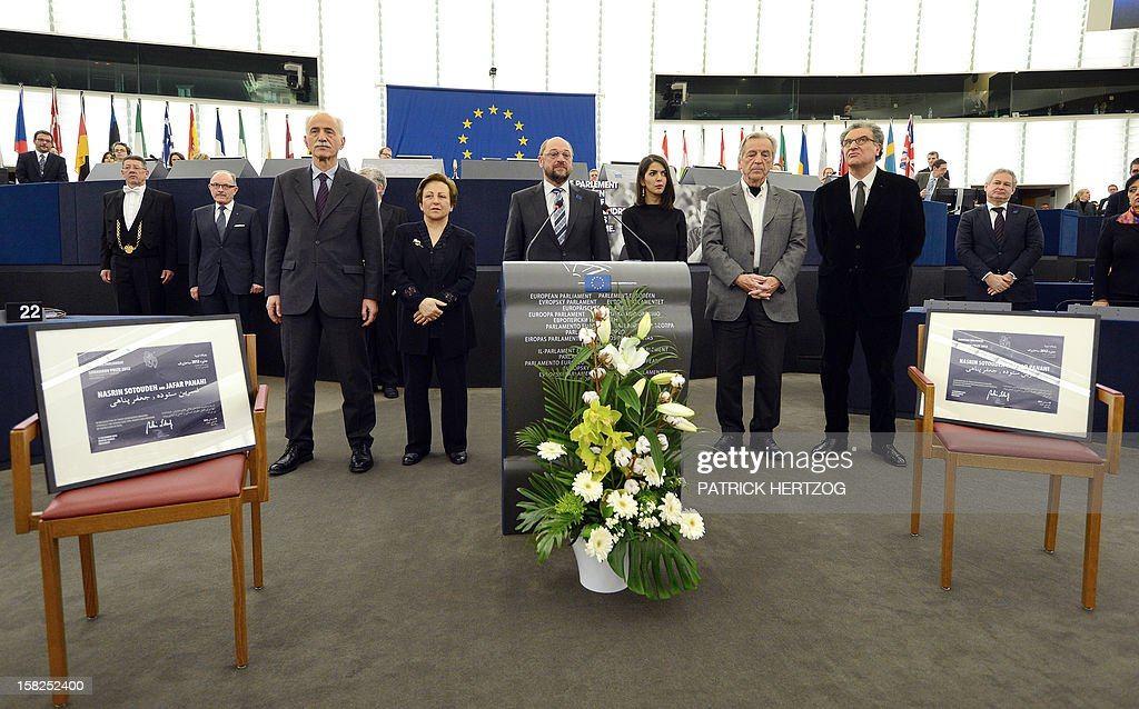 Iran's Karim Lahidji, founder of the Iranian Association of Jurists and of the League for the Defence of Human Rights in Iran, Iran's Shirin Ebadi, Nobel Peace laureate in 2003, President of the European Parliament Martin Schulz, Iran's Solmaz Panahi, daughter of Jafar Panahi, Greek-French film director Costa-Gavras, and France's Serge Toubiana, head of the Cinematheque Francaise, attend a ceremony awarding the Sakharov Prize for freedom of thought to Iranian activists, lawyer Nasrin Sotoudeh and film director Jafar Panahi, at the European Parliament in Strasbourg, eastern France, on December 12, 2012. The laureates were not able to attend the ceremony as they were not allowed to leave Iran. AFP PHOTO / PATRICK HERTZOG