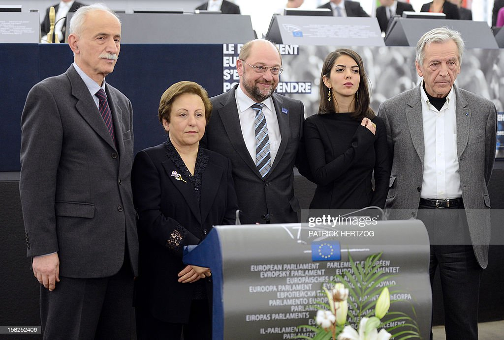 Iran's Karim Lahidji, founder of the Iranian Association of Jurists and of the League for the Defence of Human Rights in Iran, Iran's Shirin Ebadi, Nobel Peace laureate in 2003, President of the European Parliament Martin Schulz, Iran's Solmaz Panahi, daughter of Jafar Panahi, and Greek-French film director Costa-Gavras attend a ceremony awarding the Sakharov Prize for freedom of thought to Iranian activists, lawyer Nasrin Sotoudeh and film director Jafar Panahi, at the European Parliament in Strasbourg, eastern France, on December 12, 2012. The laureates were not able to attend the ceremony as they were not allowed to leave Iran. AFP PHOTO / PATRICK HERTZOG