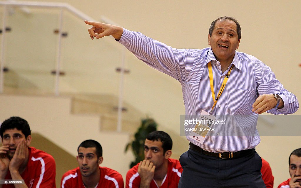 Iran's Mahram club coach Mostafa Hashemi gestures during their 21st FIBA Asia Champions Cup basketball match against Qatar's Al-Rayyan club at Al-Gharafa Indoor Stadium in Doha on May 26, 2010.