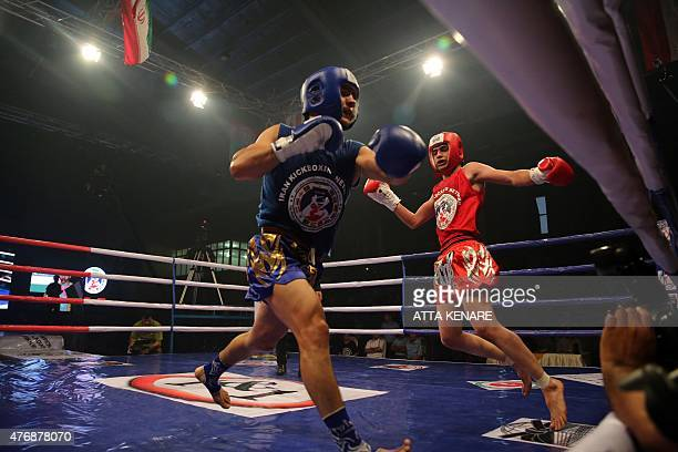 Iran's Mohamad Banar fights Uzbekistan's Dilshodbek Mirzaev of during their match in the first World Stars Kickboxing Championship in Tehran on June...