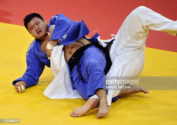 Iran's Mohammad Rodaki fights against South Korea's Kim SungMin during their bronze medal match in the 100kg category at the Judo World Championships...