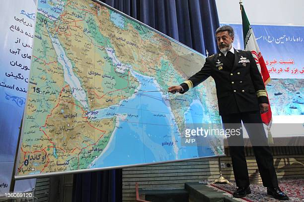 Iran's Navy Commander Admiral Habibollah Sayari points at a map during a press conference in Tehran on December 22 as saying that Iran will launch 10...
