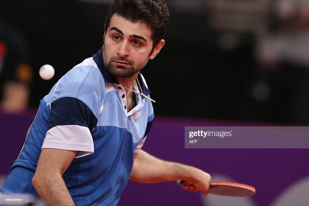 Iran's Noshad Alamyan plays against China's Hao Wang, on May 17, 2013 in Paris, during the third round of Men's Singles of the World Table Tennis Championships.