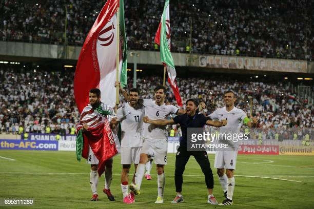 Iran's Palyers celebrates after winning the 2018 World Cup qualifying football match between Iran and Uzbekistan at the Azadi Stadium in Tehran on...
