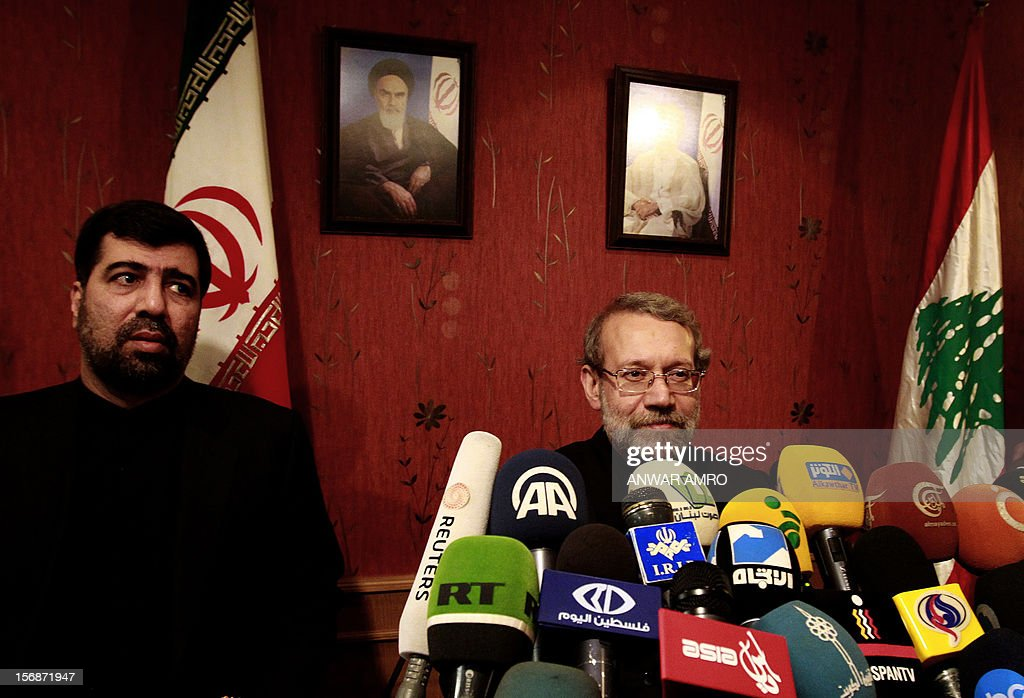Iran's Parliament speaker Ali Larijani (R) attends a press conference at a hotel in the Lebanese capital, Beirut, with Iranian ambassador to Lebanon Ghadanfar Abbadi on November 23, 2012. Larijani began a regional tour to find a solution to the conflict in his country's key ally, Syria.