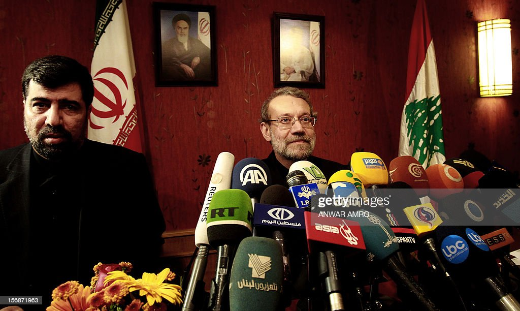 Iran's Parliament speaker Ali Larijani (R) attends a press conference at a hotel in the Lebanese capital, Beirut, with Iranian ambassador to Lebanon Ghadanfar Abbadi on November 23, 2012. Larijani began a regional tour to find a solution to the conflict in his country's key ally, Syria. AFP PHOTO ANWAR AMRO