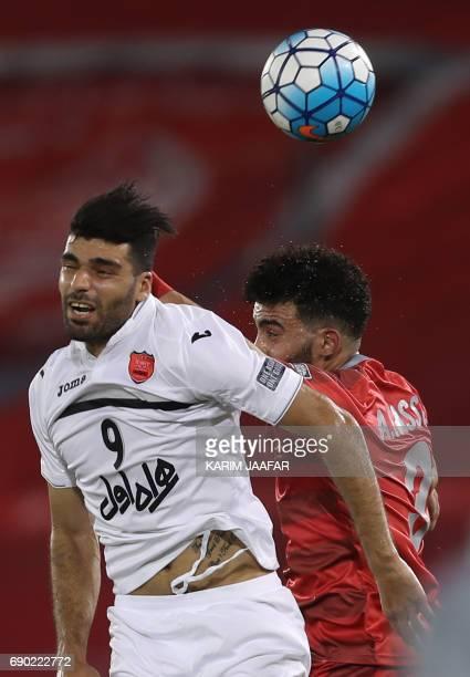 Iran's Persepolis FC forwaed Mehdi Taremi vies for the ball against Qatar's Lekhwiya SC defender Ahmed Yasser during the AFC Champions League...