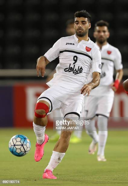 Iran's Persepolis FC forward Mehdi Taremi dribbles the ball during the AFC Champions League football match between Qatar's Lekhwiya club and...