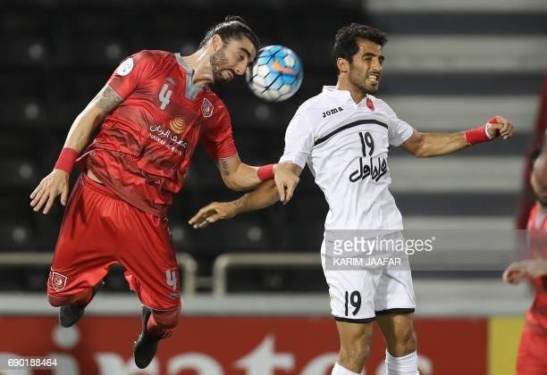 Iran's Persepolis FC forward Vahid Amiri and Qatar's Lekhwiya defender Chico Flores jump to head the ball during the AFC Champions League football...