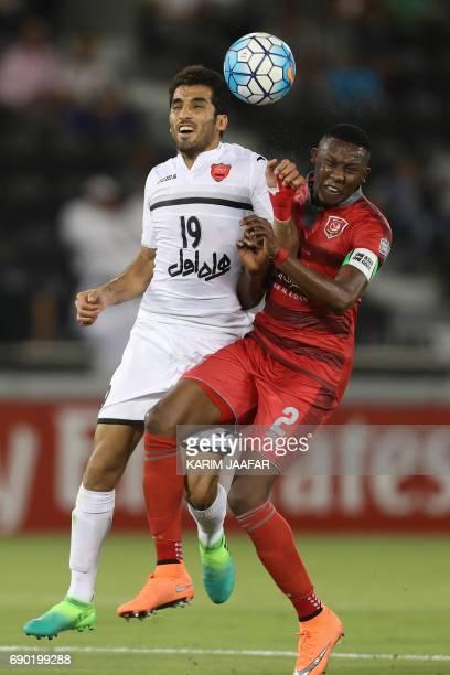 Iran's Persepolis FC forward Vahid Amiri and Qatar's Lekhwiya SC captain Mohamed Musa vie for the ball during the AFC Champions League football match...