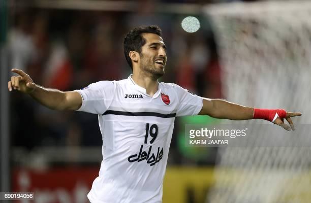 Iran's Persepolis FC forward Vahid Amiri celebrates after Qatar's Lekhwiya SC scored an own goal to give Persepolis a 10 lead during the AFC...