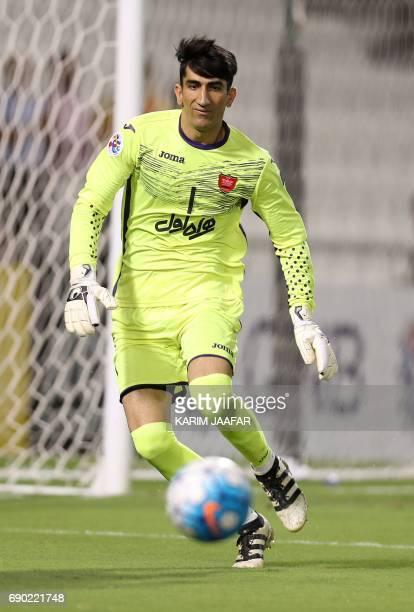 Iran's Persepolis FC goalkeeper Abolfazl Darvishvand defends during the AFC Champions League football match between Qatar's Lekhwiya club and...