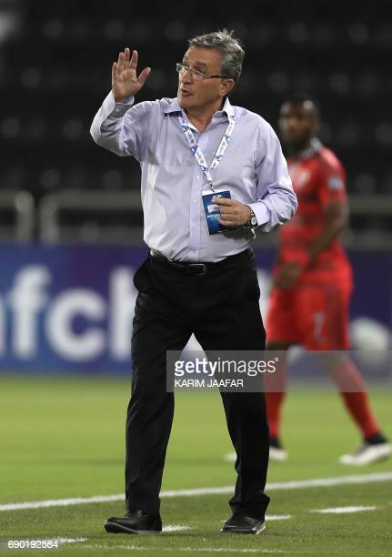 Iran's Persepolis FC Head Coach Branko Ivankovic reacts on the sidelines during the AFC Champions League football match between Qatar's Lekhwiya club...