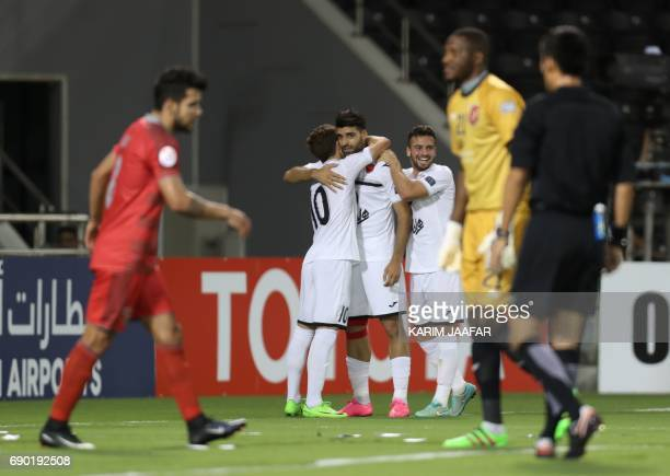 Iran's Persepolis FC players react after Qatar's Lekhwiya club scored an own goal giving them a 10 lead during the AFC Champions League football...