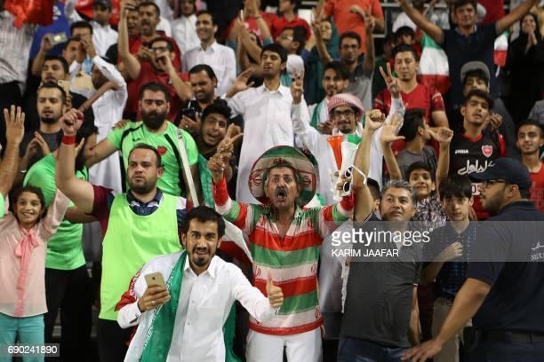Iran's Persepolis FC team fans react after their team won the AFC Champions League football match between Qatar's Lekhwiya club and Persepolis FC at...