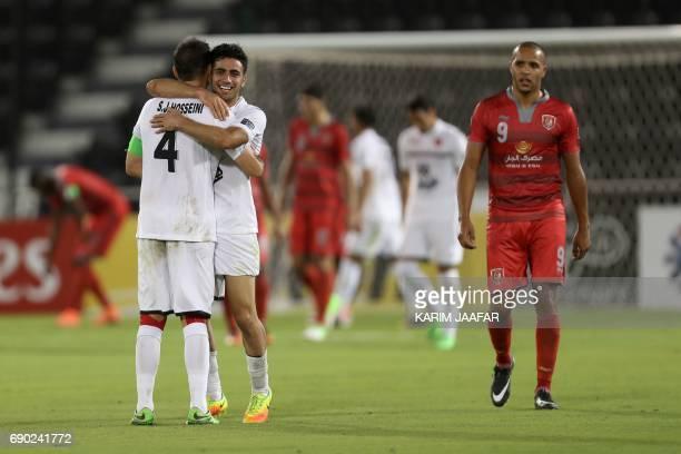 Iran's Persepolis FC team players celebrate after winning the AFC Champions League football match between Qatar's Lekhwiya club and Persepolis FC at...